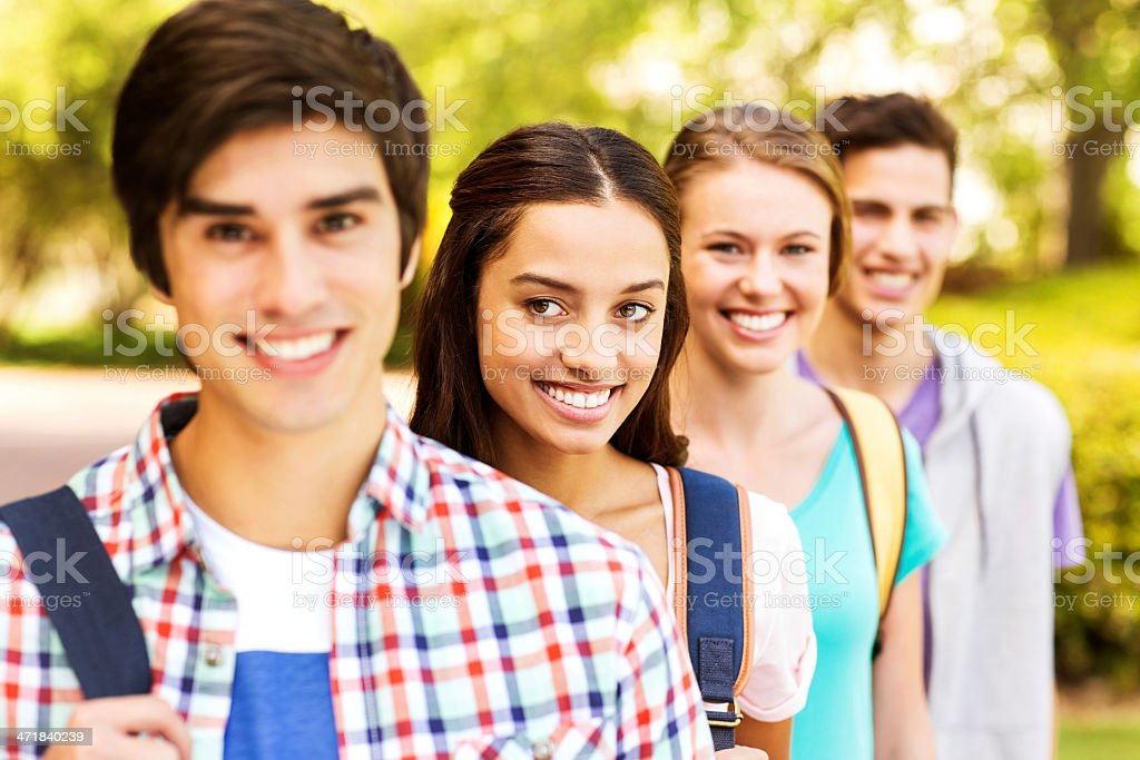 Group of College Students Standing In A Row On Campus royalty-free stock photo