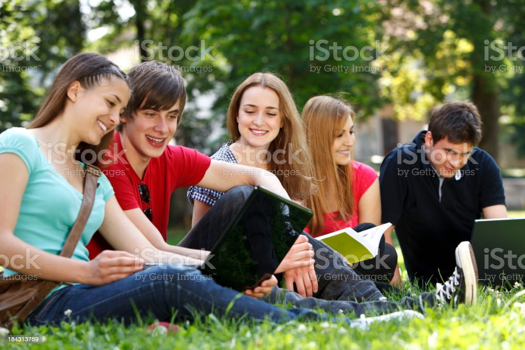 Group of college students studying at campus royalty-free stock photo
