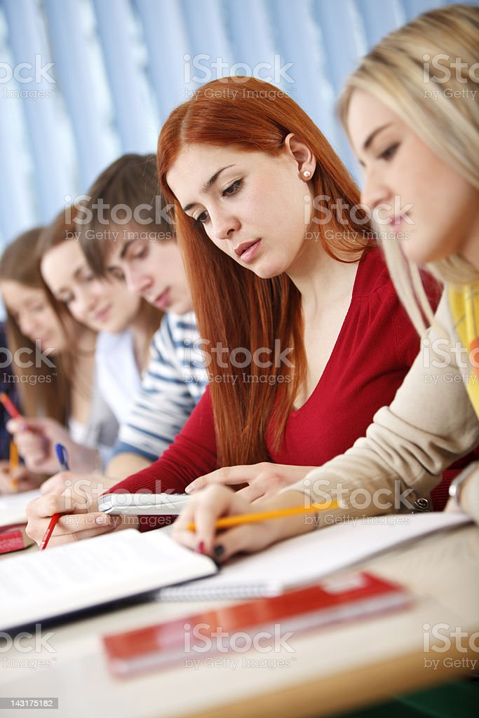 Group of college students studying in classroom royalty-free stock photo