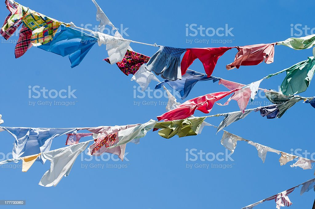 Group of colored shirts on a clothesline royalty-free stock photo