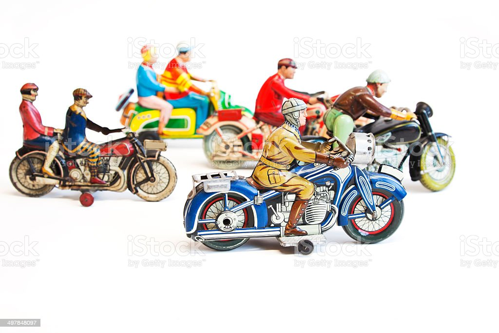 Group of colorful collectible vintage tin toy motorcycle  riders. stock photo