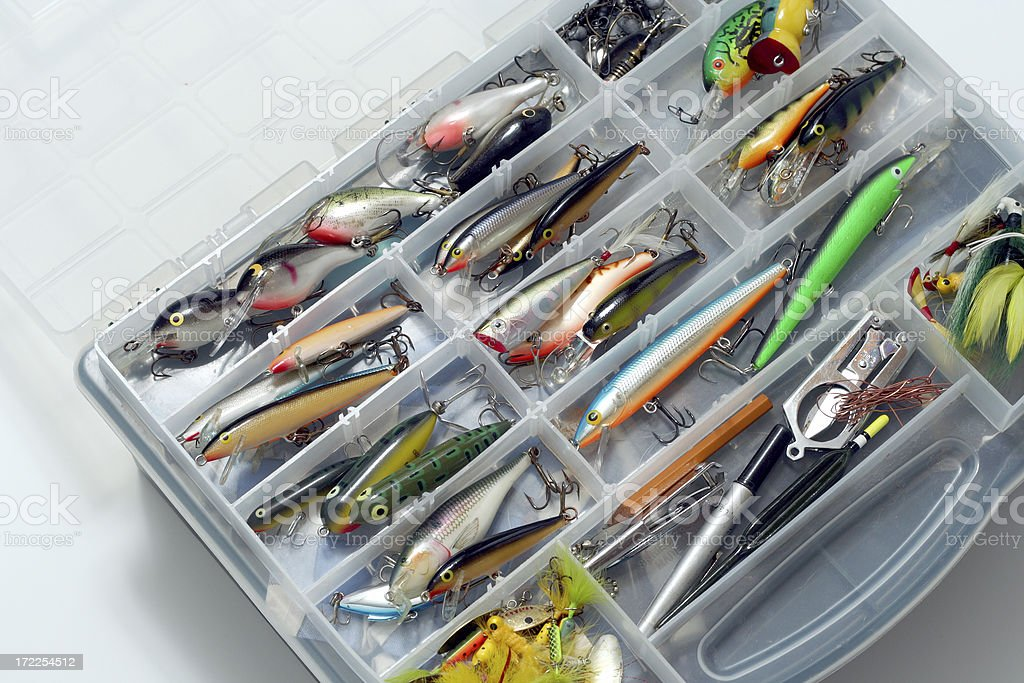 Group of colorful fishing lures with hooks in tackle box royalty-free stock photo