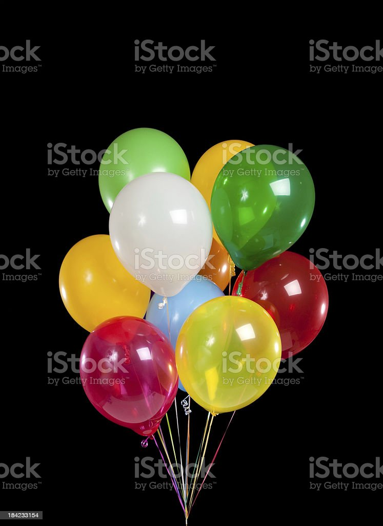 Group of colorful party balloons on black background royalty-free stock photo
