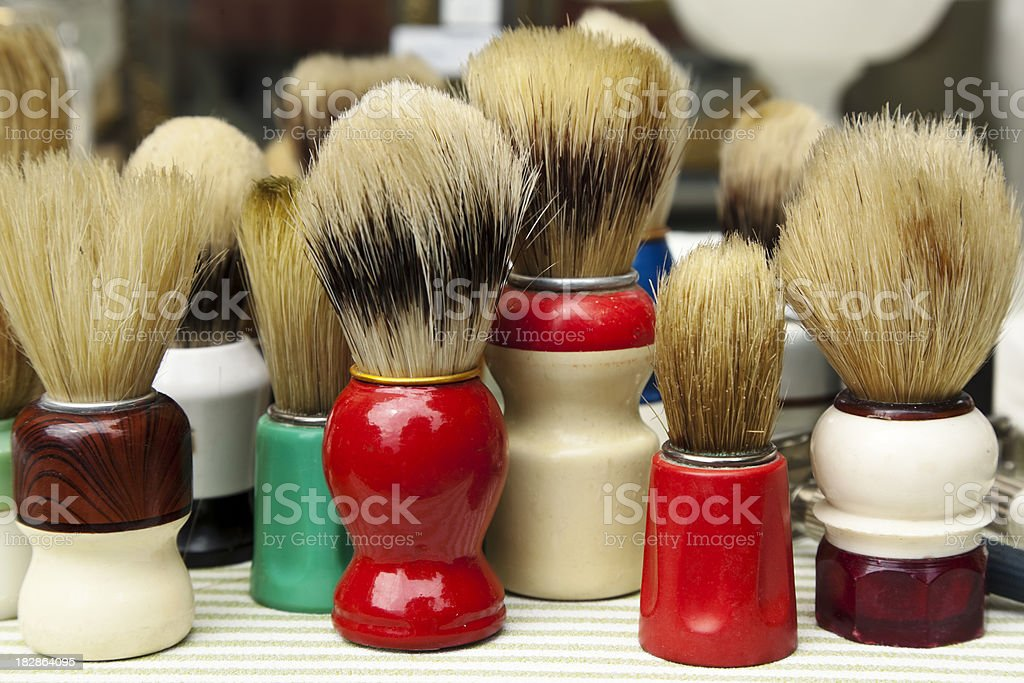 Group of colorful vintage shaving brushes on a flee market. stock photo