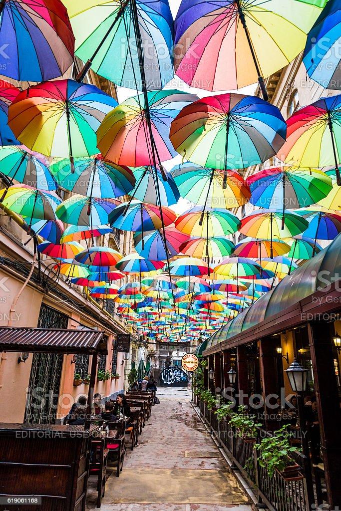 Group of Colourful Umbrellas in Narrow Street, Bucharest, Romania stock photo