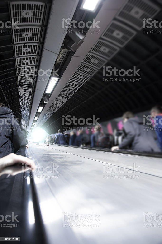 Group of Commuters on Metro Station Escalator (London Underground) stock photo