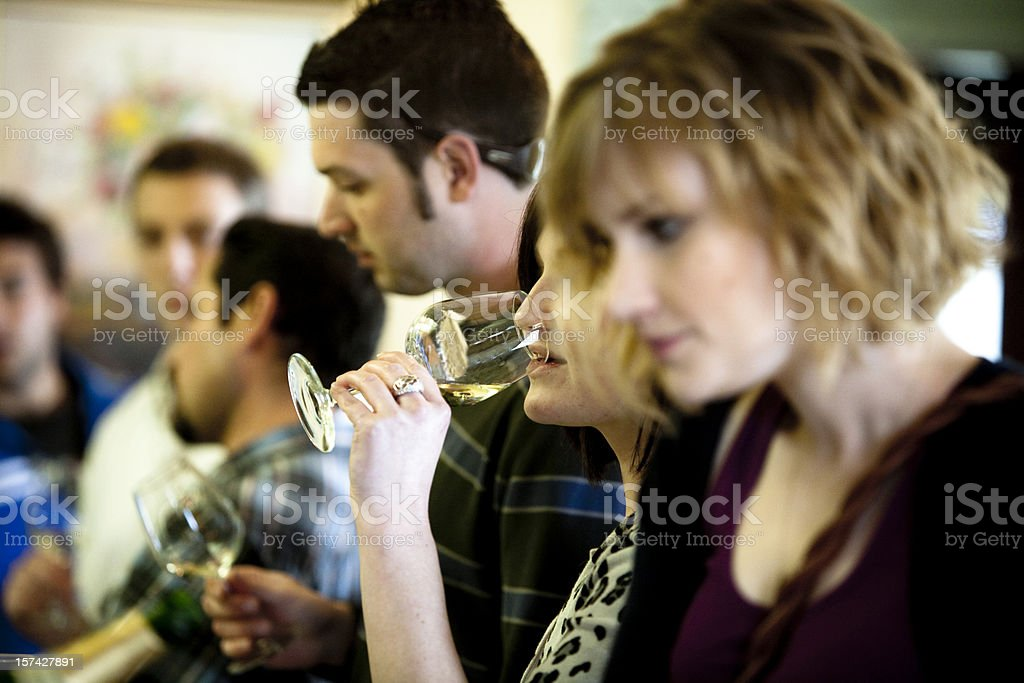 A group of connoisseurs having a wine tasting session royalty-free stock photo