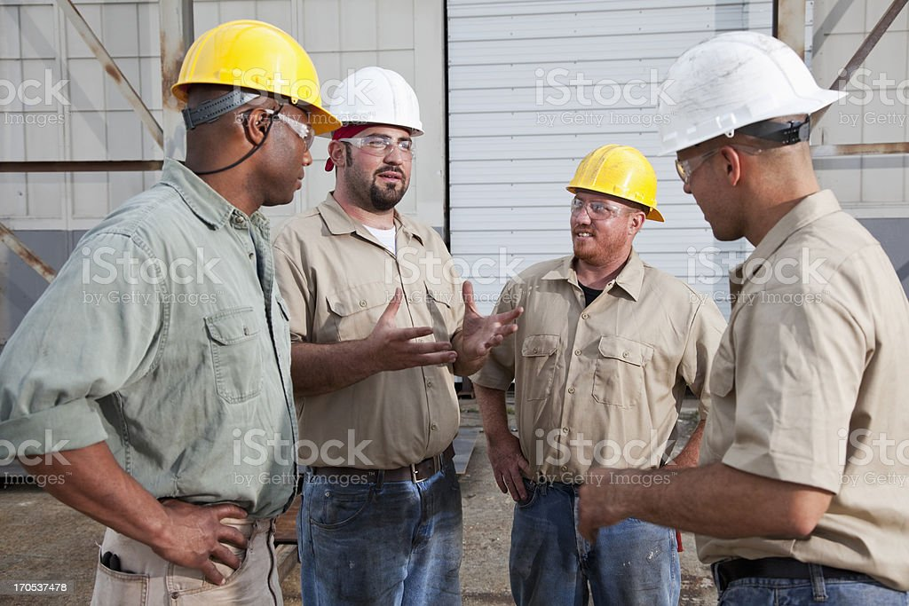 Group of construction workers talking royalty-free stock photo