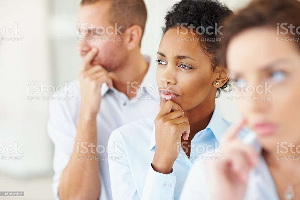Group of contemplative business colleagues royalty-free stock photo