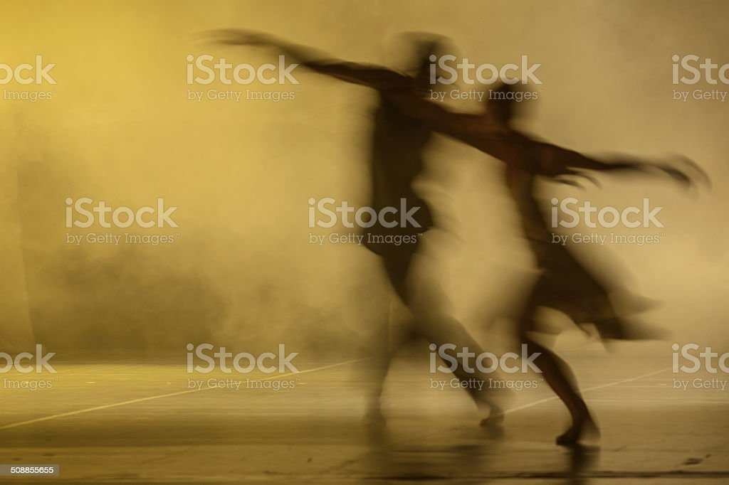 Group of contemporary dancers performing on stage stock photo