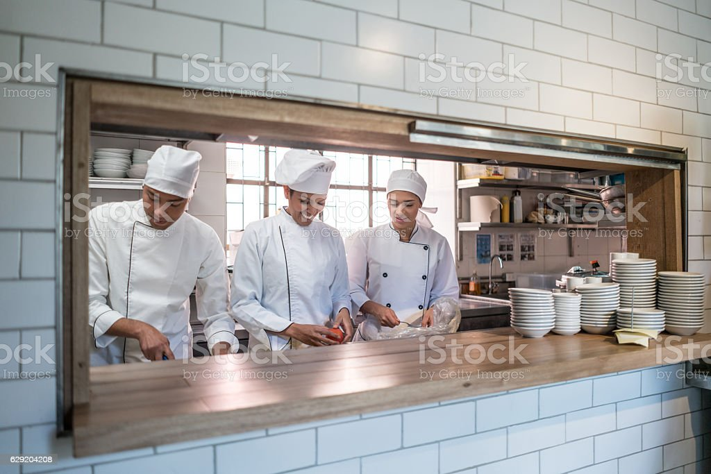Group of cooks working at a restaurant stock photo