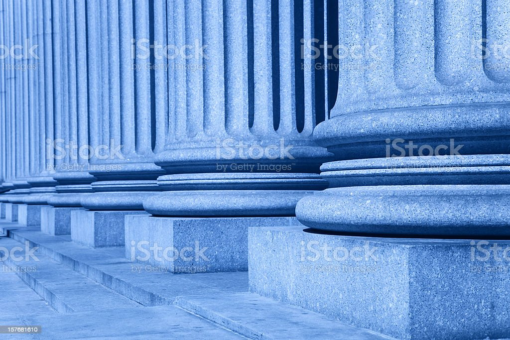 group of corporate blue business columns with steps stock photo