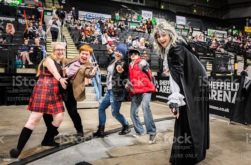 Group of cosplayers having fun stock photo