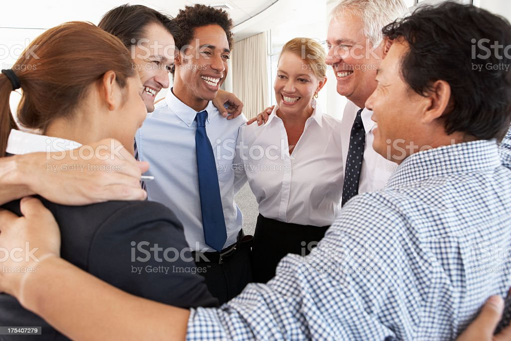 Group of coworkers bonding in a circle at a company seminar royalty-free stock photo