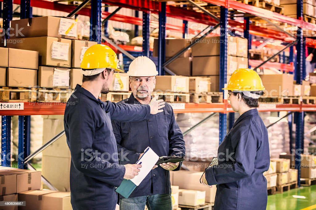 Group of Coworkers in Warehouse royalty-free stock photo