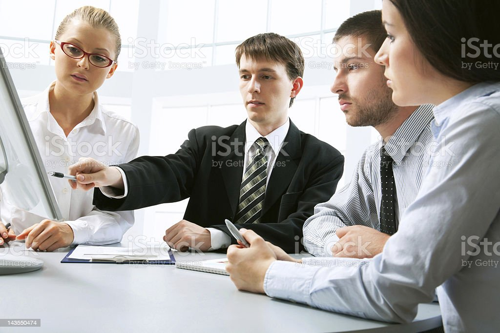 A group of coworkers working as a team royalty-free stock photo