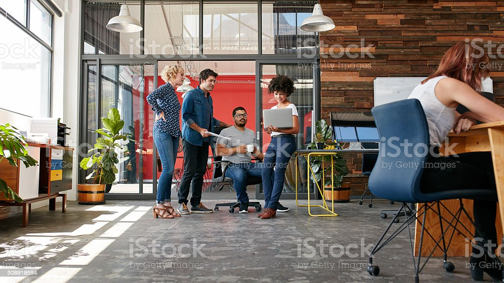 Group of creative people having a meeting stock photo
