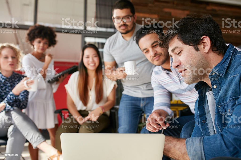 Group of creative people in a meeting discussing new project stock photo