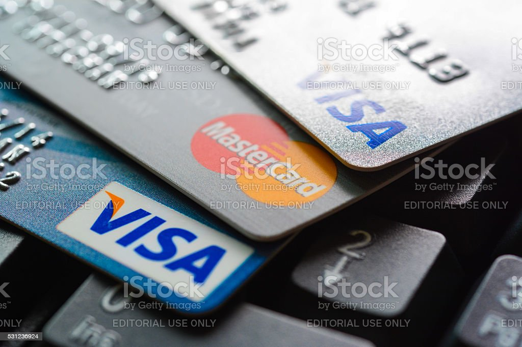 Group of credit cards on computer keyboard stock photo