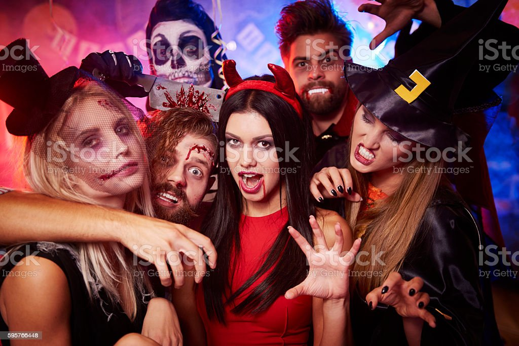 Group of creepy friends at the party stock photo