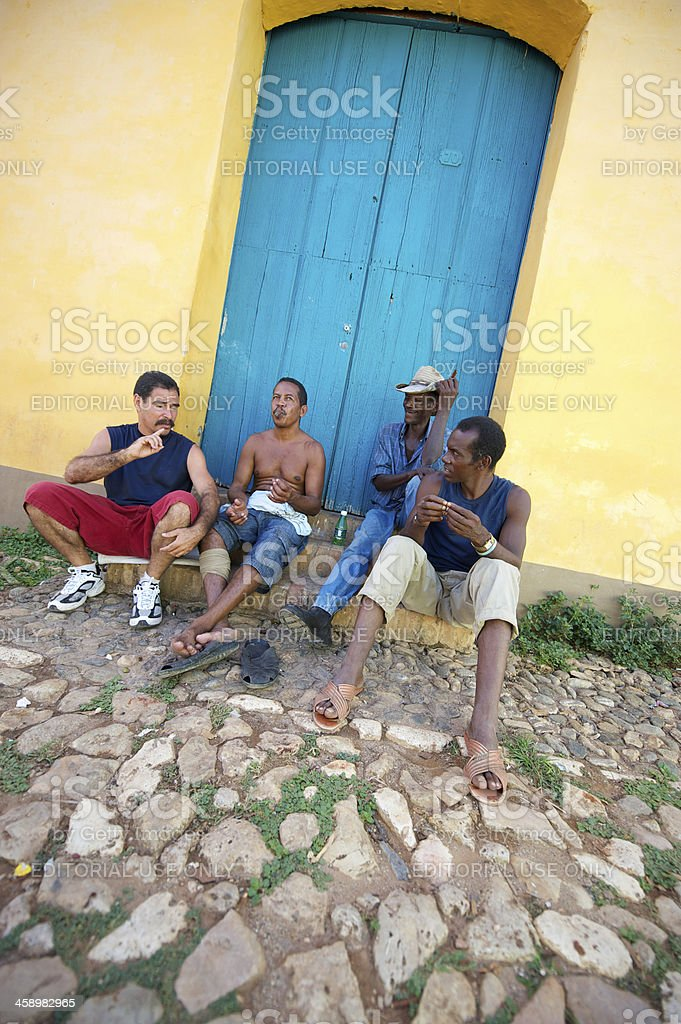 Group of Cuban Men Sit Together by Blue Door royalty-free stock photo