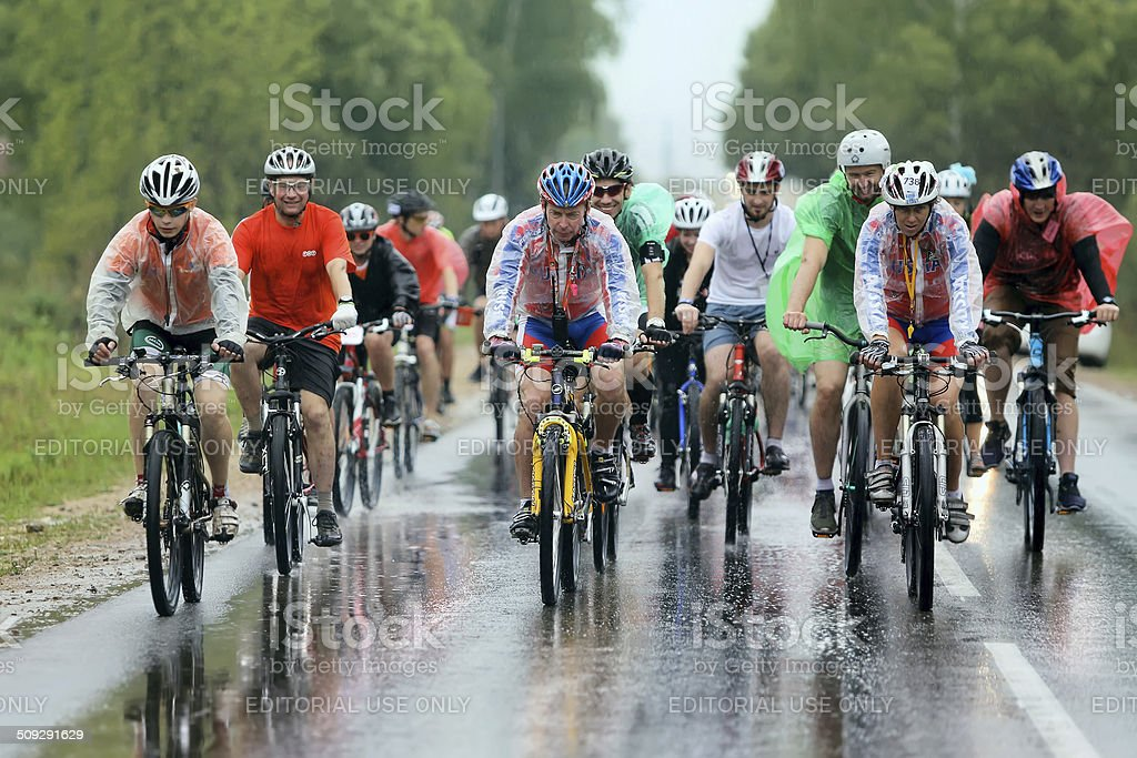 Group of cyclist racer racing  in the rain stock photo