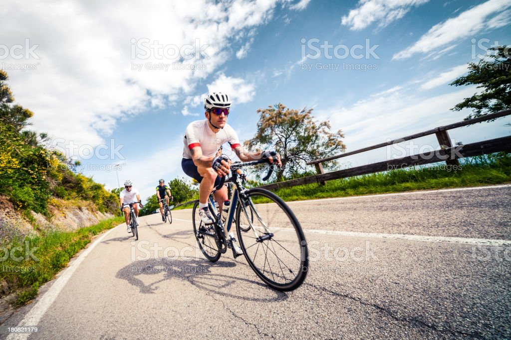 Group of cyclist riding on a countryroad stock photo
