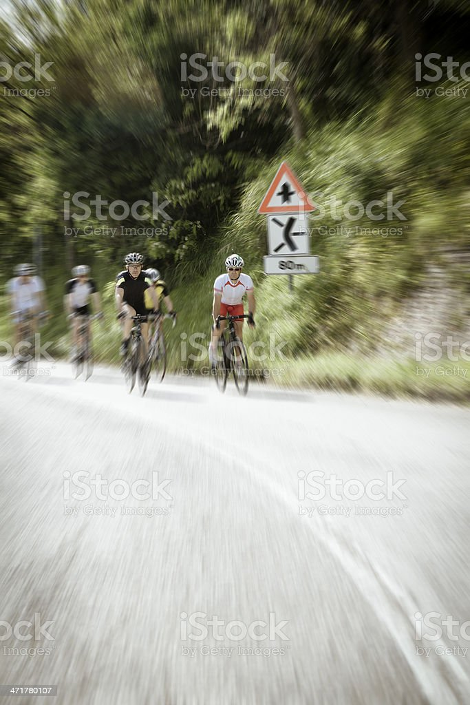 Group of cyclists on the road royalty-free stock photo