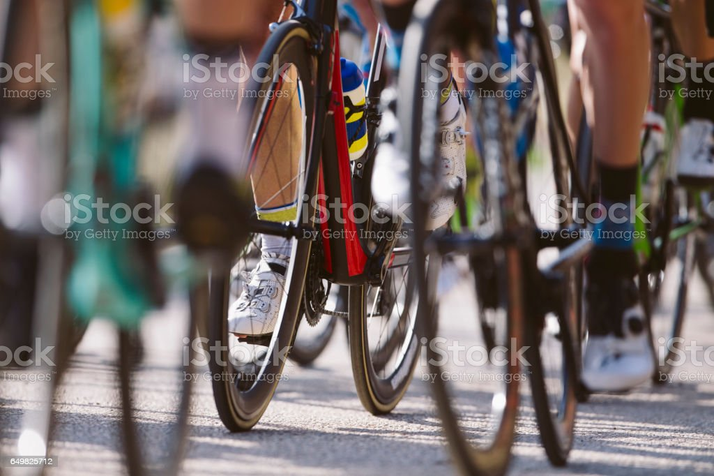Group of cyclists riding a bike in a cycling race. Racing Bike. stock photo