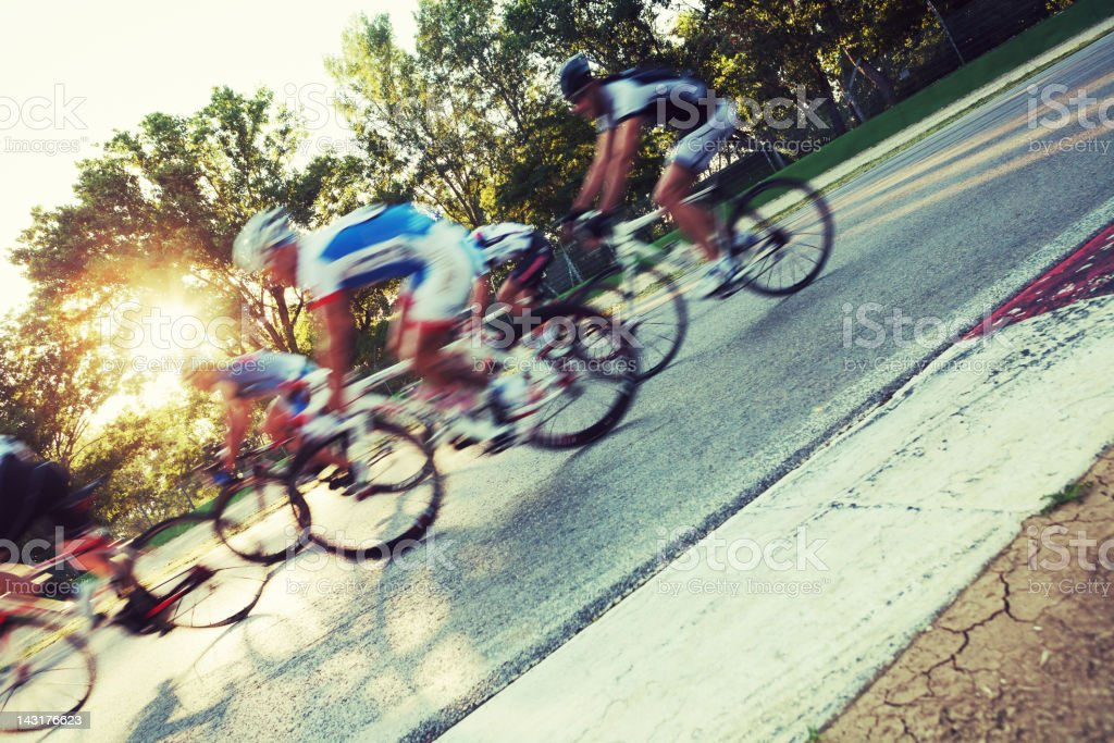 Group of cyclists rushing by camera stock photo