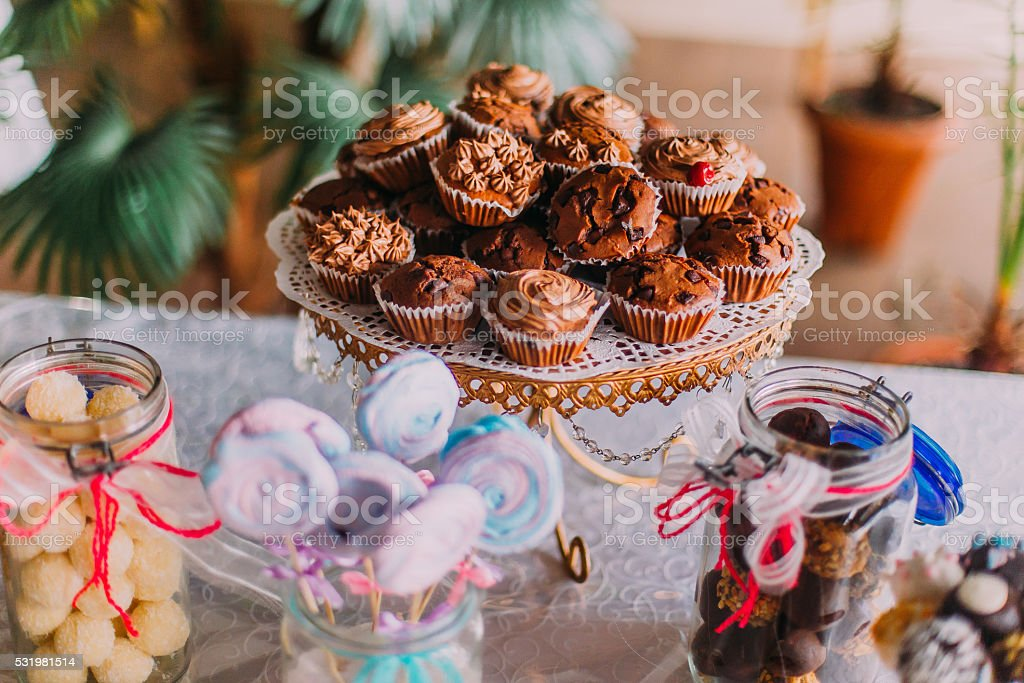 Group of delicious chocolate cupcakes s and candy bar at stock photo