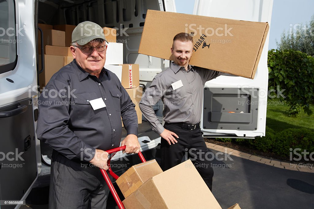 Group of delivery man with a parcel. stock photo