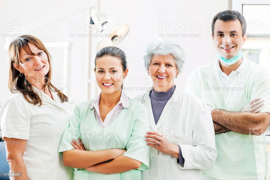 Group of dentists and dental assistants royalty-free stock photo