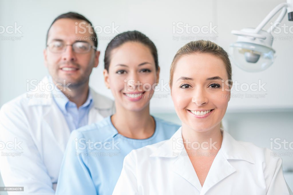 Group of dentists smiling stock photo