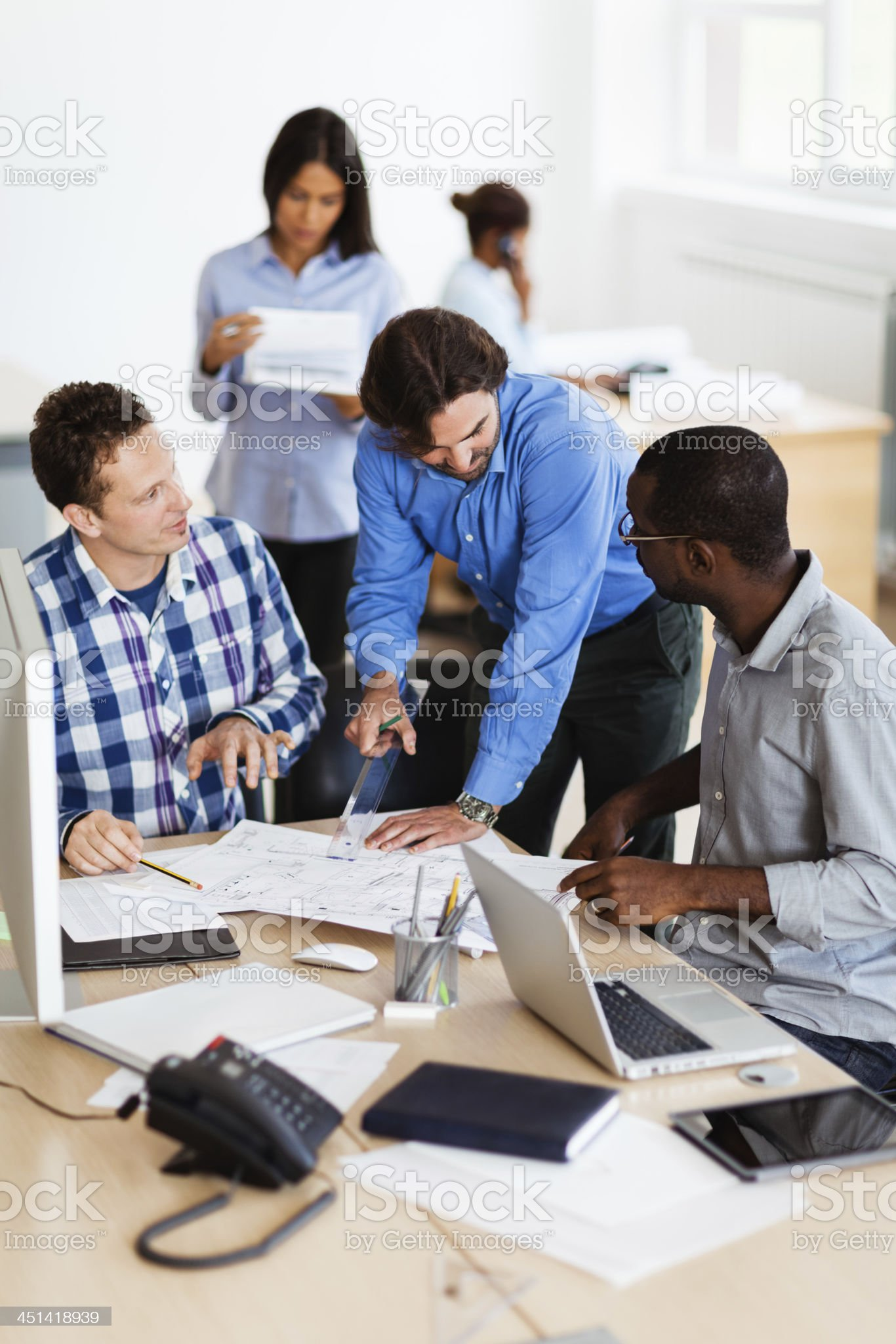 Group of designers working together royalty-free stock photo