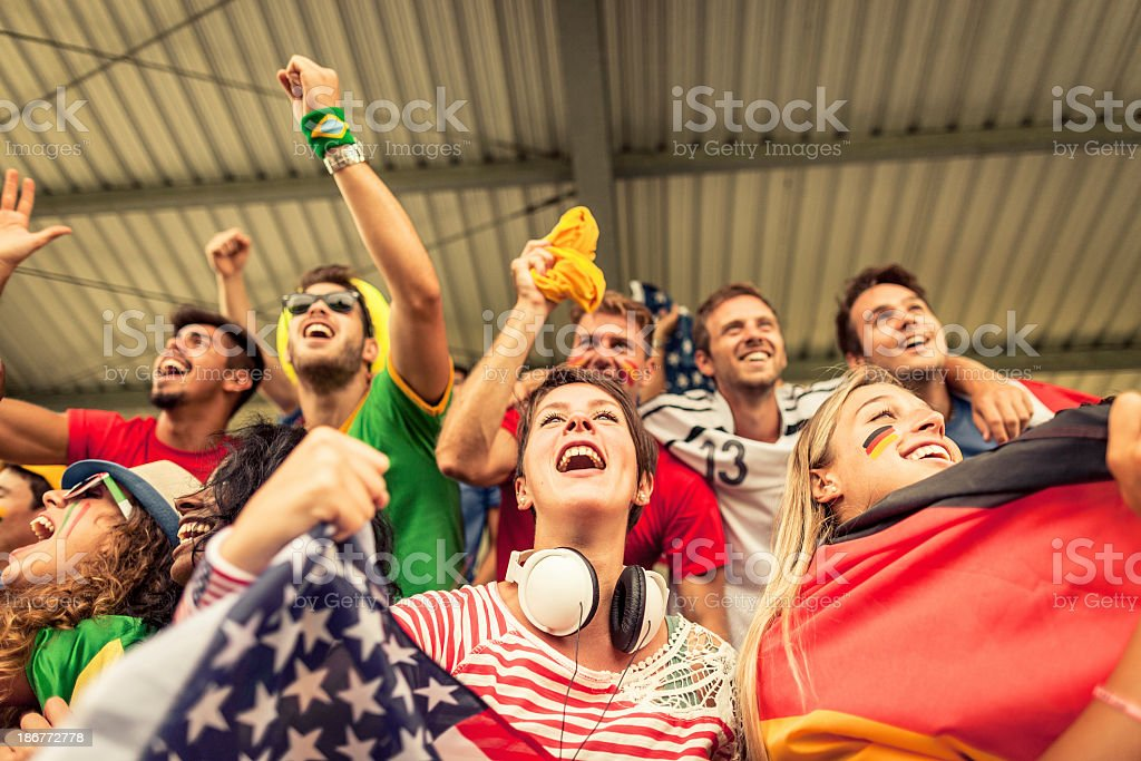 Group of different nations supporters together stock photo