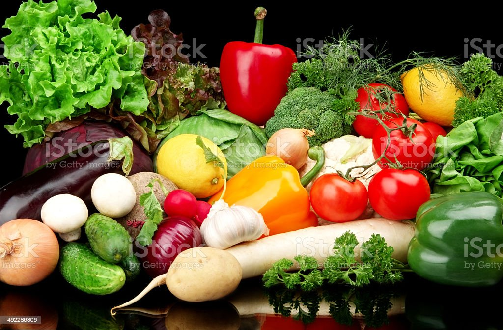 Group of different vegetables on black background stock photo