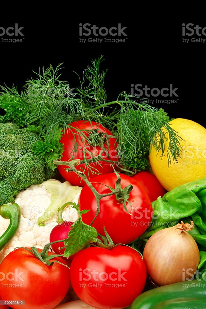 Group of different vegetables on black vertically stock photo