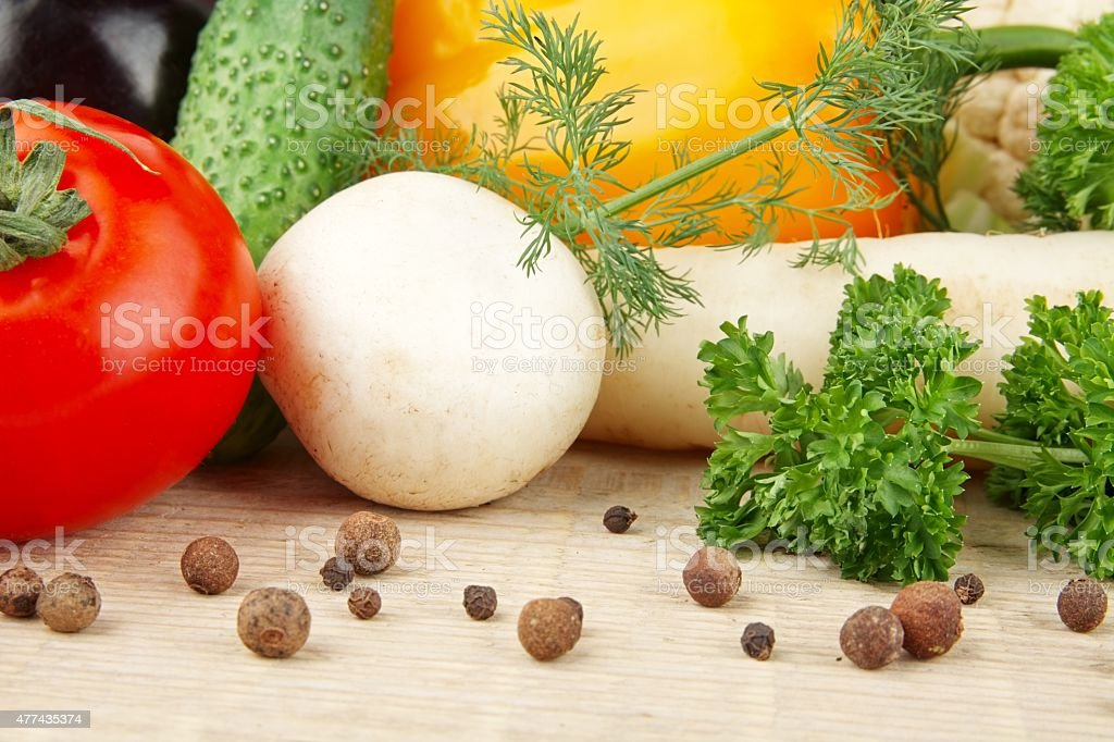 Group of different vegetables on wooden board stock photo