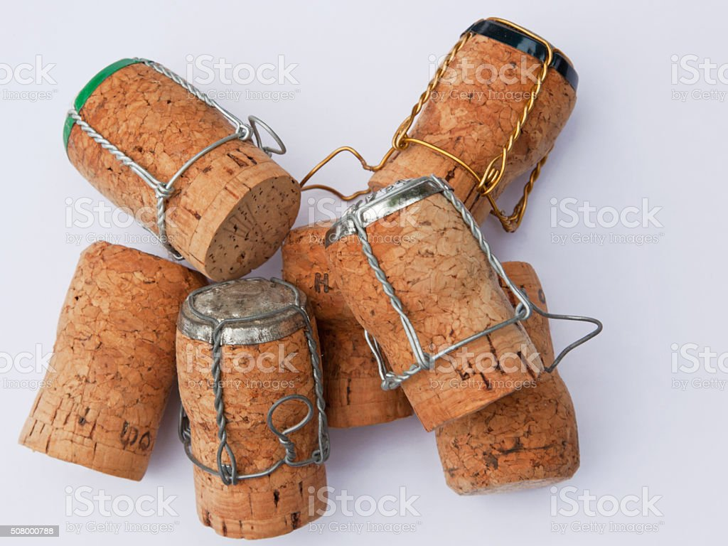 Group of discarded corks from empty champagne bottles stock photo