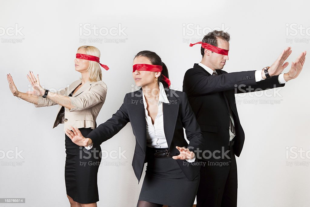 Group of disoriented businesspeople royalty-free stock photo