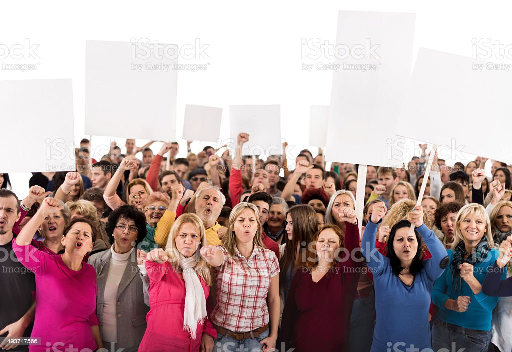 Group of displeased people holding banners and looking at camera stock photo