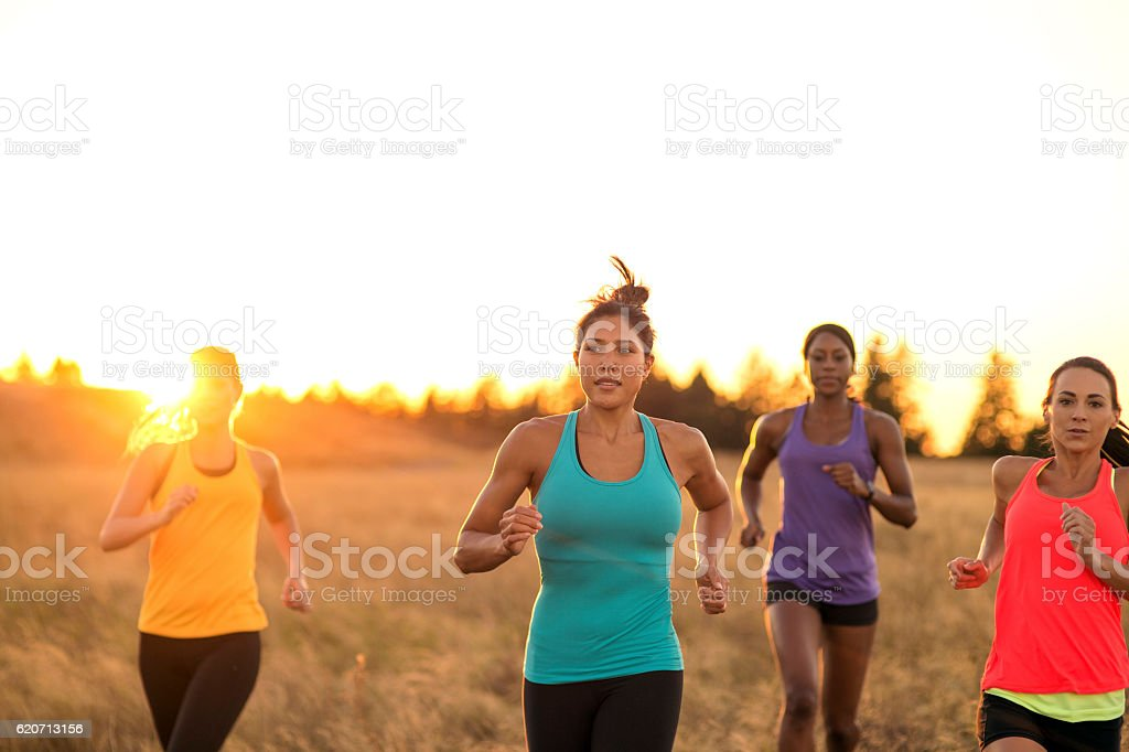 Group of diverse adult females trail running stock photo