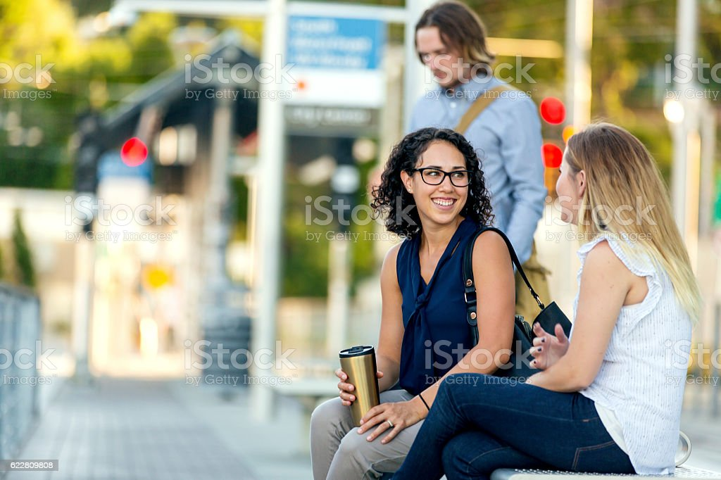 Group of diverse adult professionals waiting for public transit stock photo