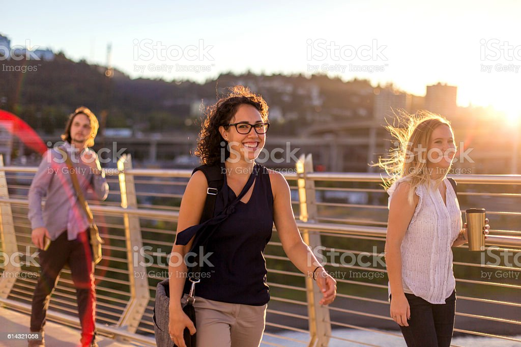 Group of diverse adult professionals walking to work stock photo