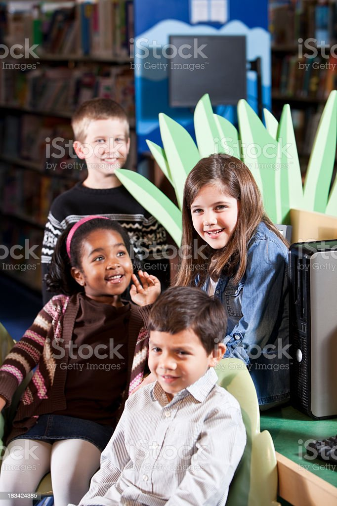 Group of diverse children in the library stock photo