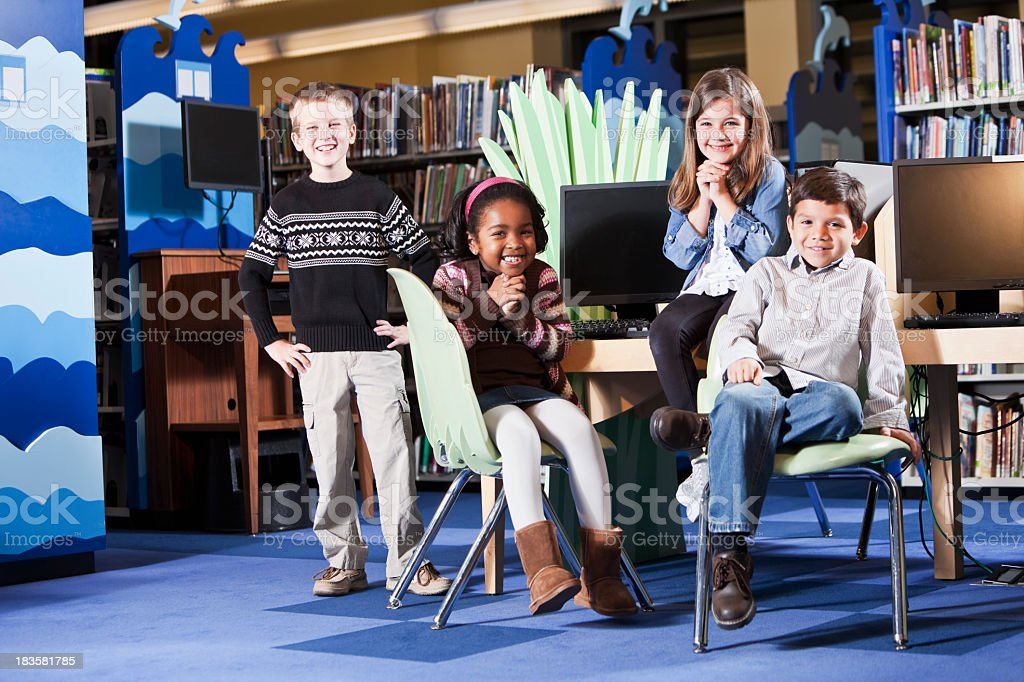Group of diverse children in the library royalty-free stock photo