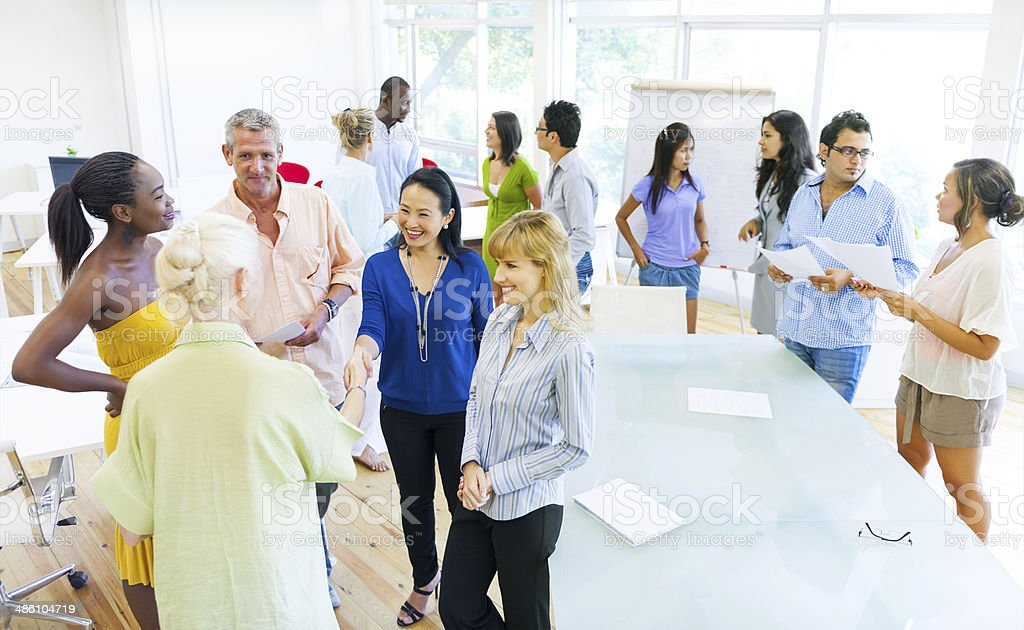 Group of Diverse Colleagues greeting stock photo