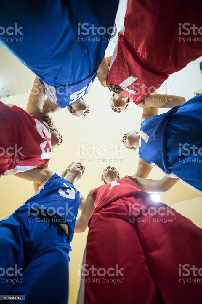 Group of diverse female athletes in a team huddle stock photo