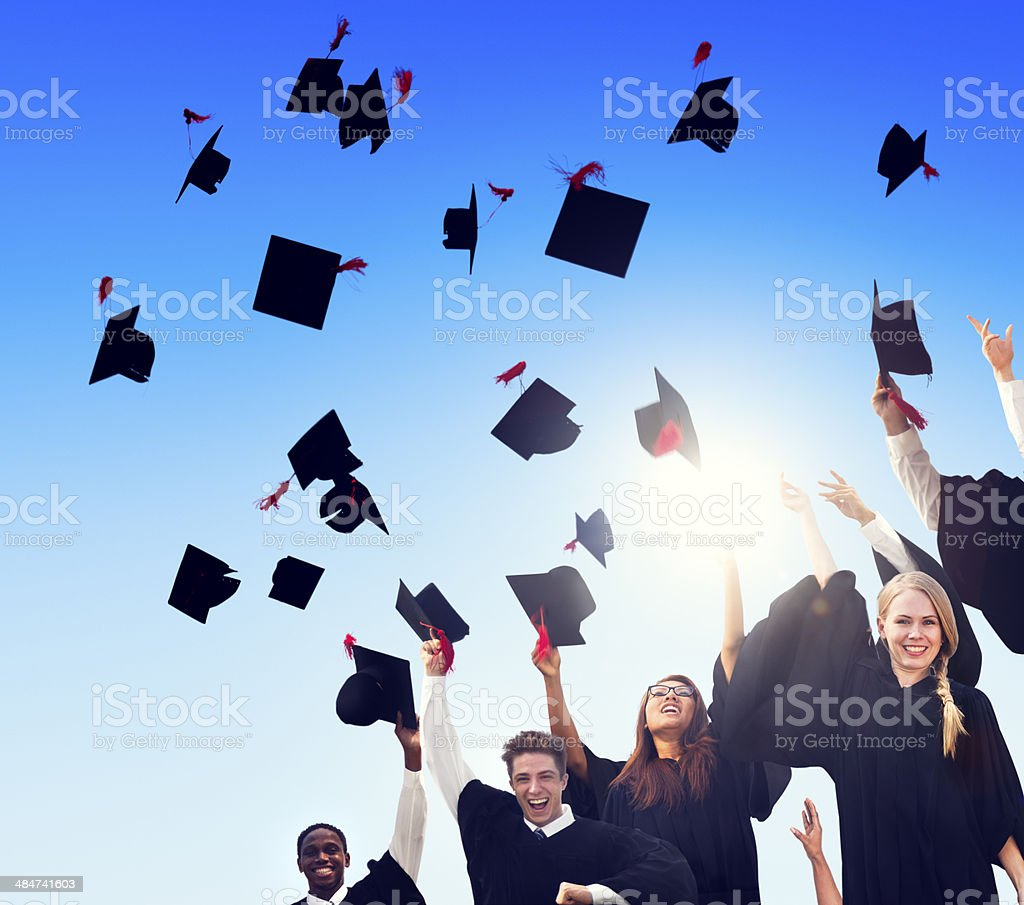 Group Of Diverse International Student Celebrating Their Graduat stock photo